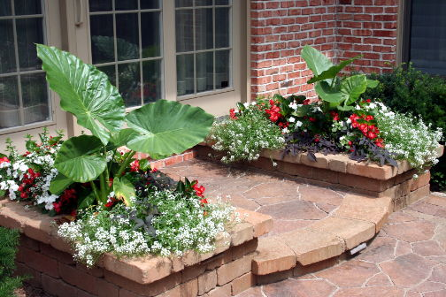 brick planter by a porch